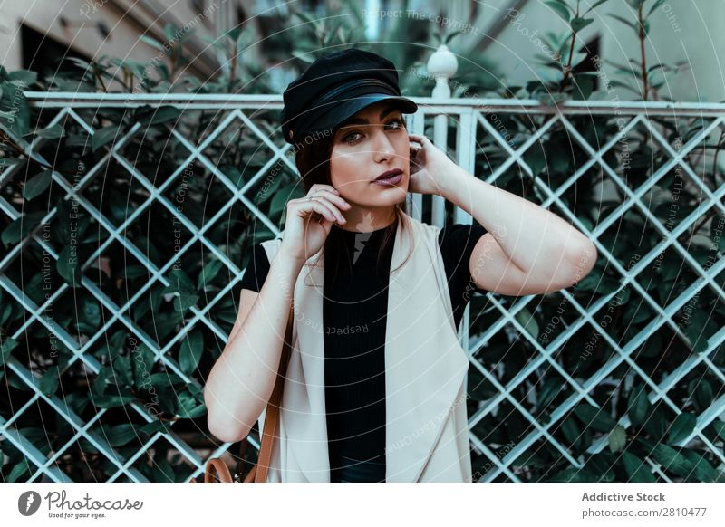 Pretty stylish woman putting on cap Woman Style Youth (Young adults) Street Beautiful Cap Fence