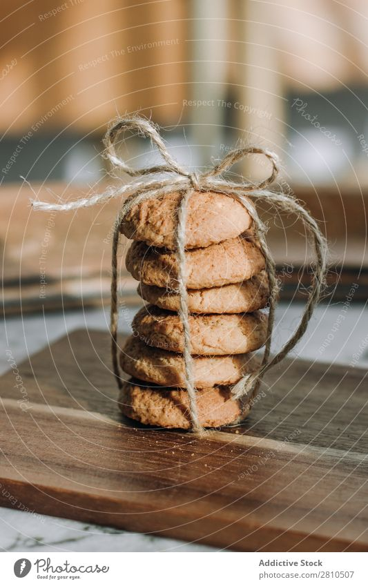 Stack of cookies with a rope and tie Cookie Sweet Food Table Snack Dessert White Fresh Drinking Delicious To feed Kitchen Breakfast Sugar Home Tasty Healthy