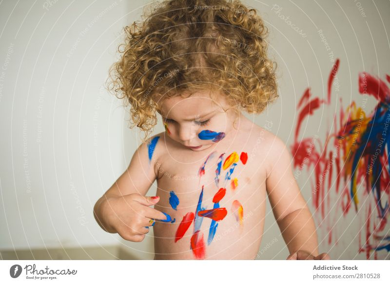 Child getting dirty with paints Painting (action, artwork) Small Draw Delightful Bright Body Art Drawing Infancy Colour Joy Artist Painter Education Cute
