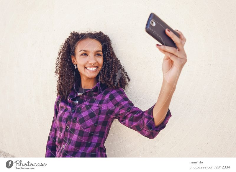 Young casual woman using her smartphone Work and employment Telephone Cellphone PDA Technology Internet Human being Feminine Young woman Youth (Young adults)