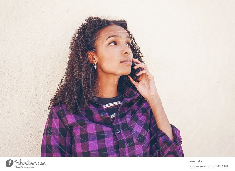 Young casual woman using her smartphone Woman Human being Youth (Young adults) Young woman Black 18 - 30 years Adults Natural Feminine Emotions