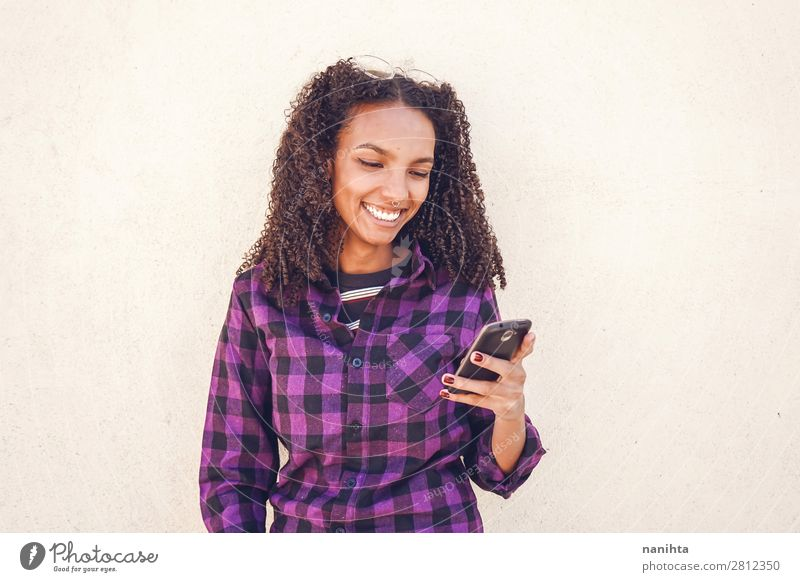 Young casual woman using her smartphone Work and employment Telephone Cellphone PDA Technology Entertainment electronics Telecommunications Internet Human being