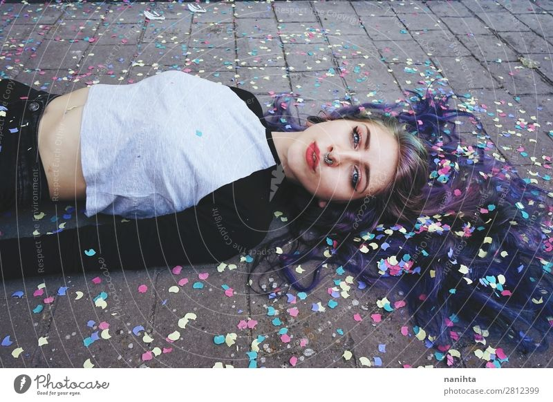 Beautiful young woman surrounded by confetti Woman Human being Youth (Young adults) Young woman 18 - 30 years Face Lifestyle Adults Feminine Emotions Style