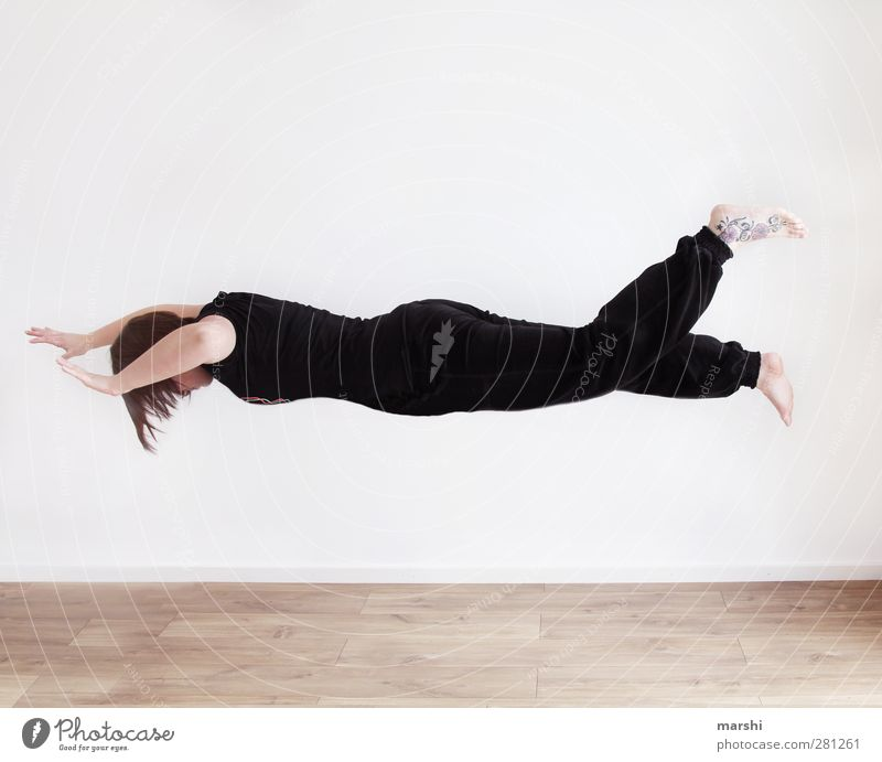 weightless in space Sports Human being Feminine Young woman Youth (Young adults) Woman Adults Body 1 Flying Emotions Joy Departure Hover Weightlessness Black