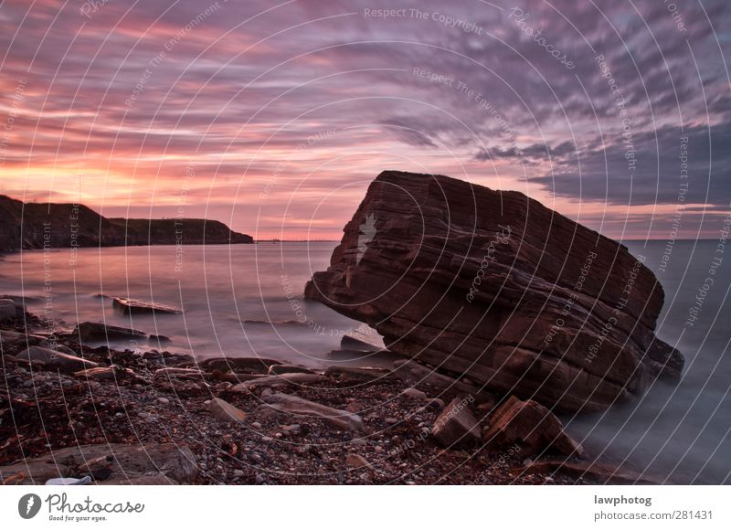 Sunset at Whitley Bay Nature Landscape Sand Water Sky Clouds Night sky Sunrise Sunlight Beautiful weather Rock Coast Beach Colour photo Multicoloured Abstract