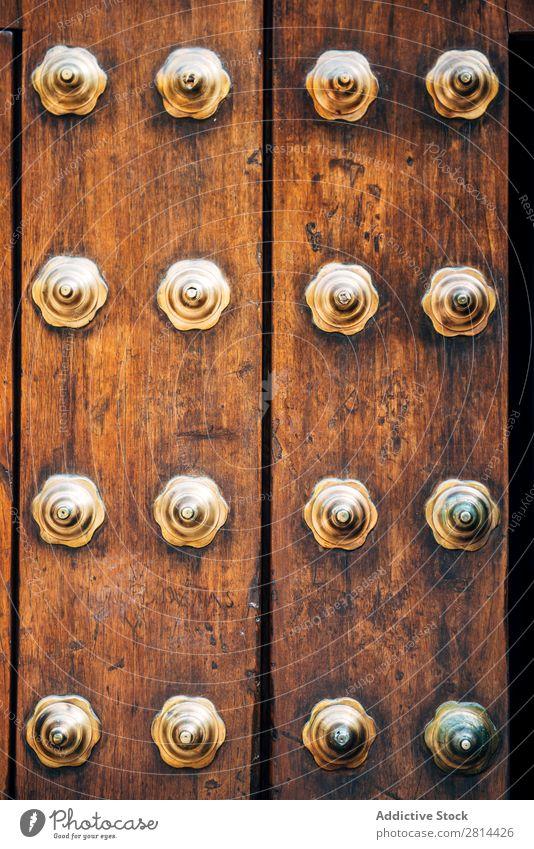 Antique Wooden Door with metal decoration. Texture background Zanzibar Old Indian Design Classic Background picture Rustic oriental Moslem doorway Exterior shot