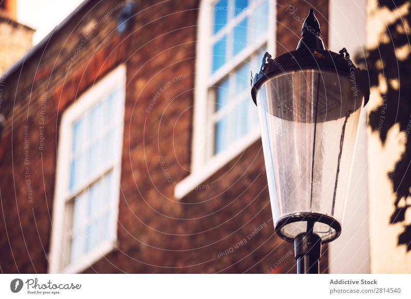 Lamppost over house. Lamp post House (Residential Structure) London Street England British City Architecture Great Britain Europe Building Vintage Town Light