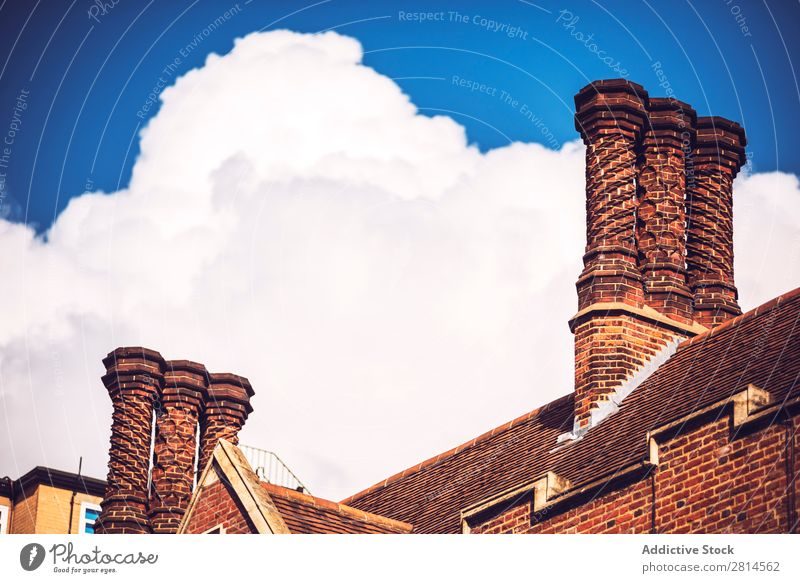 Brick chimney over clouds. Chimney Clouds London Sky England Architecture Building Roof fancy Europe Great Britain English Old Structures and shapes