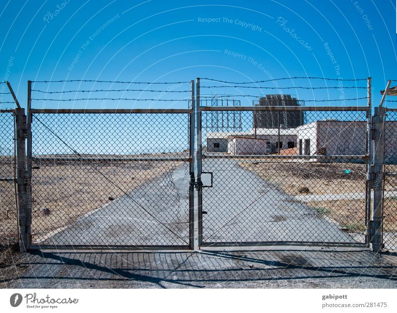 You're not going to get me in trouble. Information Technology Landscape Cloudless sky Summer Drought Crete Outskirts Deserted Industrial plant Ruin Gate