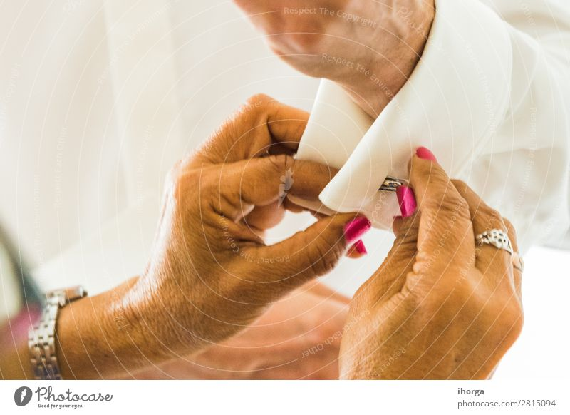 A groom putting on cuff-links in his wedding day. Luxury Elegant Style Wedding Office Business Human being Masculine Man Adults Hand Fingers Fashion Clothing