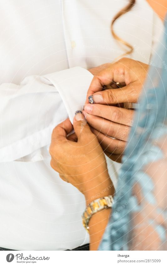 A groom putting on cuff-links in his wedding day. Elegant Style Wedding Office Business Human being Masculine Feminine Woman Adults Man Hand Fingers Fashion