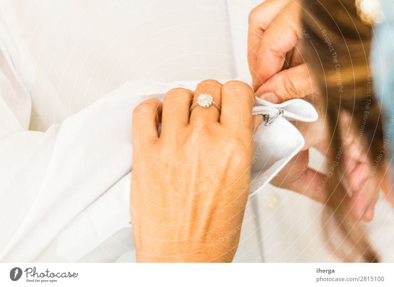 A groom putting on cuff-links in his wedding day Luxury Elegant Style Wedding Office Business Human being Masculine Woman Adults Man Hand 2 Fashion Clothing
