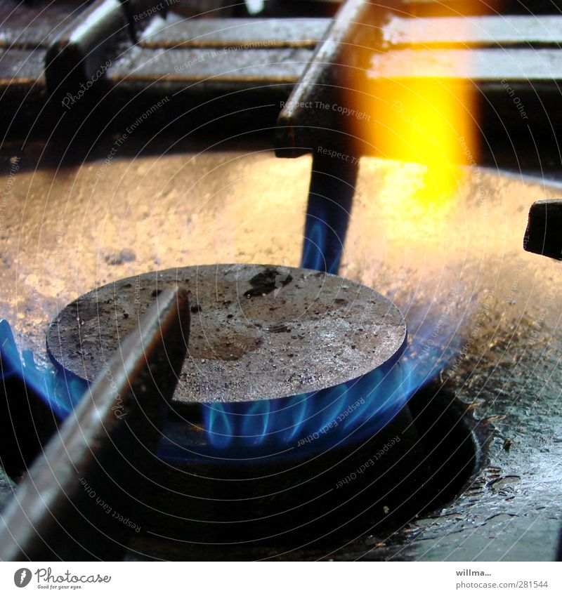 Step on it! Kitchen Energy industry Hot Blue Yellow Black Cast iron Gas flame Gas stove Fireglow Flame Burn Nostalgia Colour photo Interior shot Detail Deserted