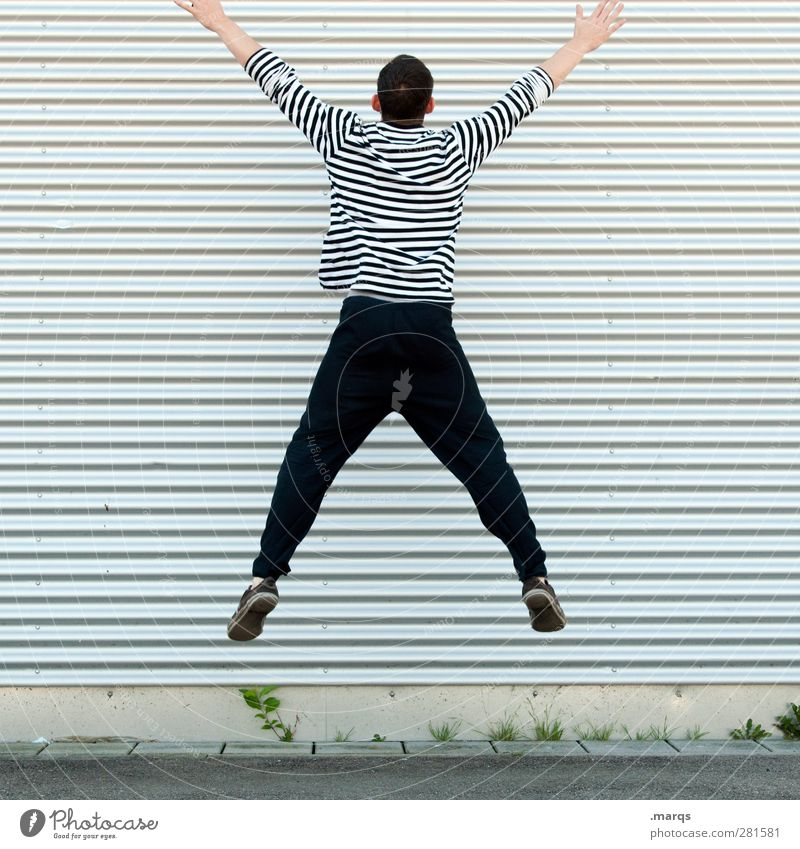 Human being Youth (Young adults) Adults Wall (building) Wall (barrier) Young man Jump Line Body Exceptional Facade Masculine Stripe Athletic Border Whimsical