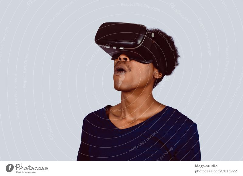 Afro American man experiencing virtual reality. Design Joy Playing Entertainment Business Headset Technology Human being Man Adults Shirt Beard Modern New