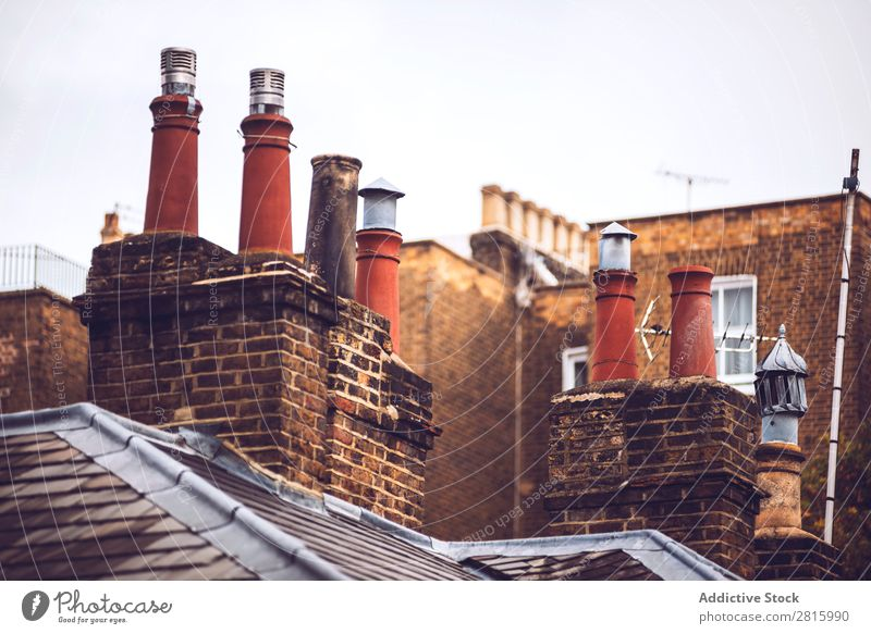 Rooftop chimneys of London rooftops Chimney Sky Blue Building Background picture Home Architecture Great Britain Brick City House (Residential Structure)