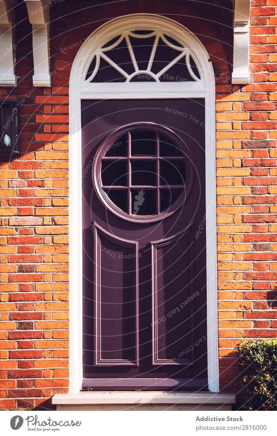 View of one vibrant purple door with round windows on London str Vintage Door Bright Black Yellow Front door Round