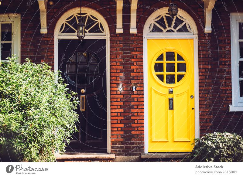 Bright vintage doors. Vintage Door London Black Yellow styled Front door Round Window Glass Wood Colour Multicoloured Exterior shot Front view Entrance