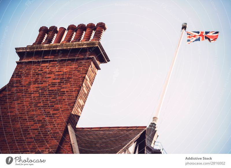 British flag on a building Flag Hang Building patriotic national Wall (building) Street City Town Old London Horizontal Exterior shot Deserted Great Britain