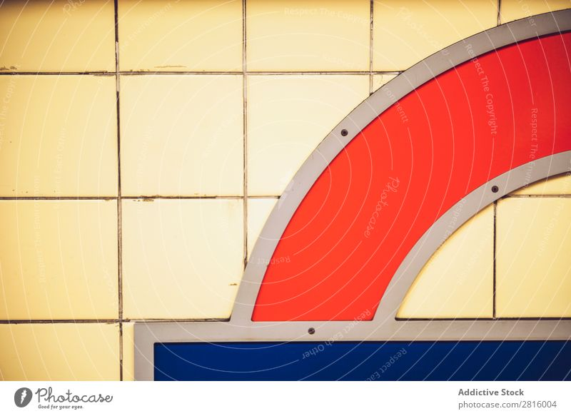 LONDON, UK - OCTOBER 15, 2016: Part of wall in London subway Consistency Wall (building) Underground Design Brick Interior design Yellow Red Blue Clean