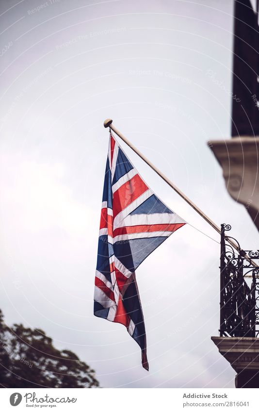 British flag Flag Sky Great Britain Hang Building patriotic national Wall (building) Street City Town Old London Vertical Exterior shot Deserted Copy Space