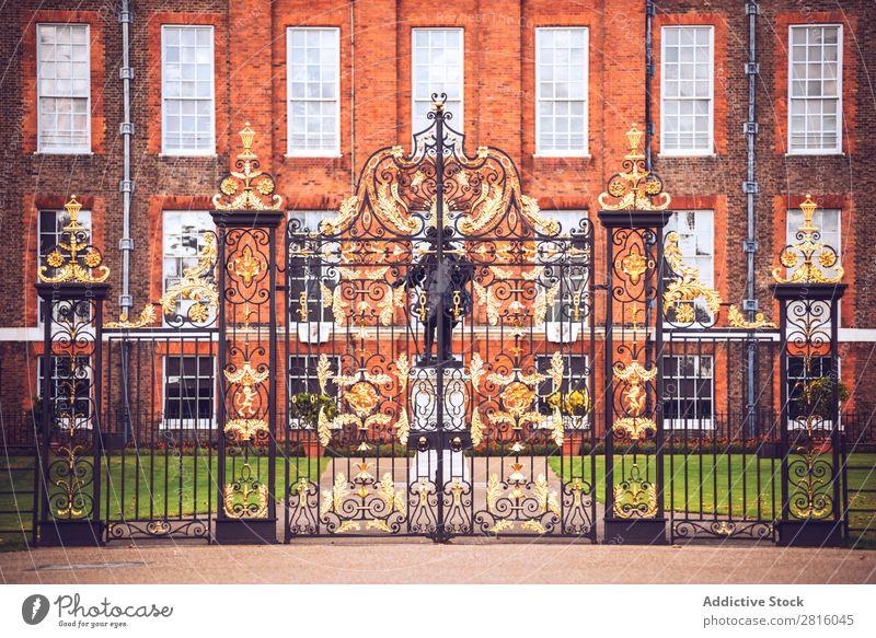 London, UK - October 13, 2016:Antique golden gates to Kensington Gate Gold Palace Royal England Historic Decoration Iron Art Monument Guard Entrance
