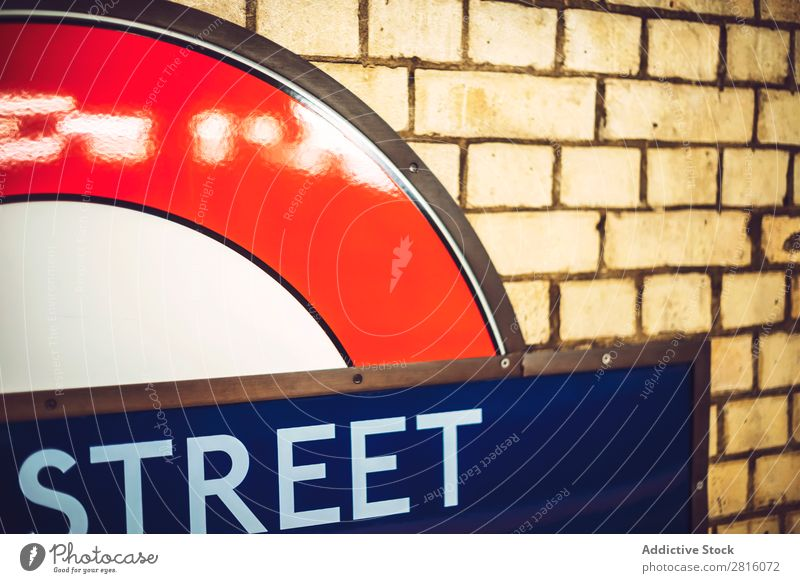 LONDON, UK - OCTOBER 14, 2016: London Underground Sign Close-up Railroad Station Transport Platform City Town Deserted Tunnel phone booth Red Exterior shot