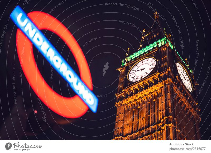 Underground sign and Big Ben tower in London. Horizontal outdoor Tower Monument Architecture Sign Desk Station Transport City Town Deserted Red Exterior shot