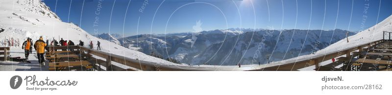 Sky Sun Winter Cold Mountain Snow Vantage point Large Beautiful weather Alps Panorama (Format) Cloudless sky Terrace Ski resort Skier Nature