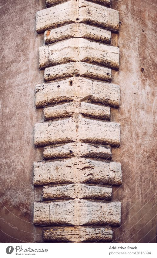 Corner of a building texture background. Rome, Italy Building Brick Stone Surface Decoration Cement Rough Square Old Ornament Tile Brown Masonry brickwork