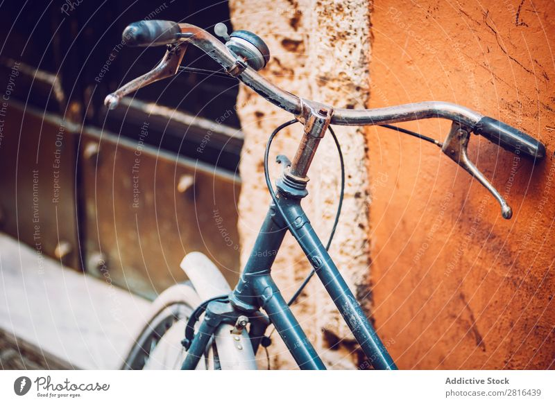 Bike stands on the old city street. Italy. Rome. Appearance Background picture Bicycle Building City Skyline Classic Day Design Horizontal