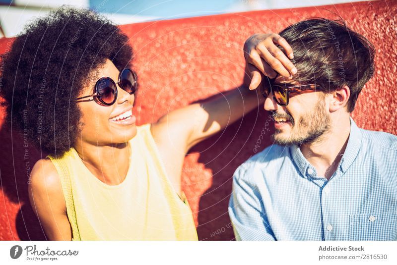 Interracial couple having fun on the rooftop Ethnic Youth (Young adults) Racing sports Caucasian Exterior shot Park African-American Boy (child)