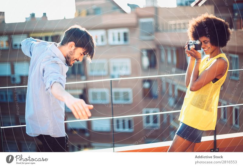 Interracial young couple taking pictures to each other and having fun Youth (Young adults) handsome Multicultural interracial Summer Exterior shot Easygoing