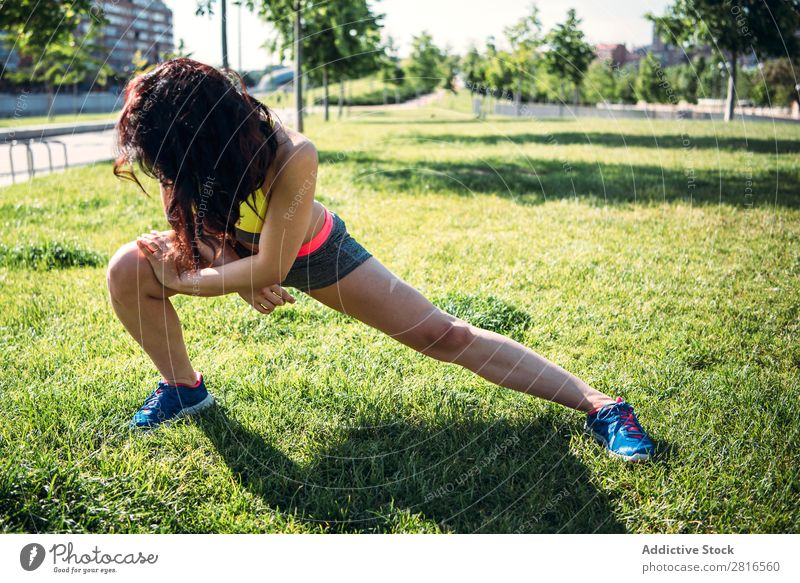Woman warming up before outdoor workout stretch Runner Light Sports Preparation copy Practice Sit Day Bright Sunbeam Jogger Copy Space Summer Morning Fitness