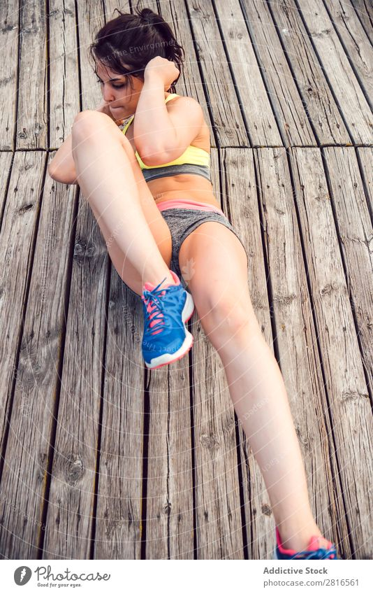 Young Woman working out outdoors and having fun Exterior shot Athletic Fitness Gymnasium Summer workout Park pushup Thin Determination Adults Strong Human being