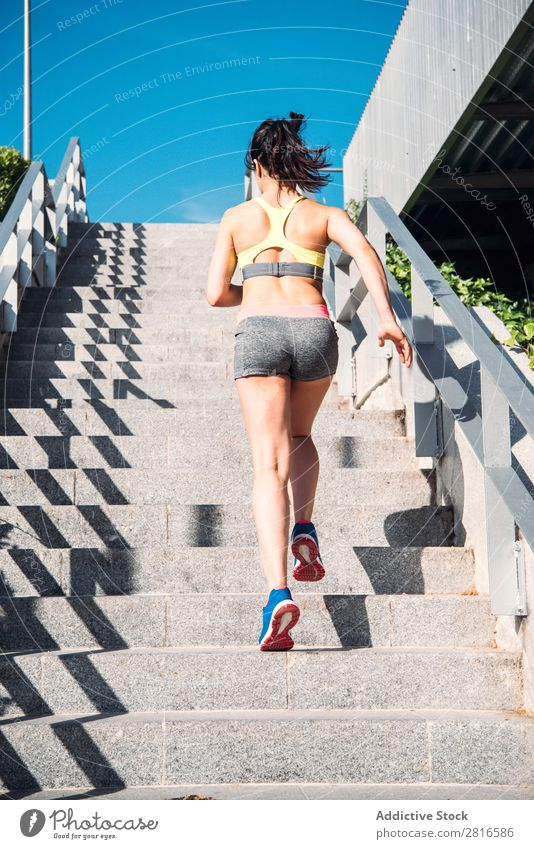 Athletic woman running up stairs during cardio - interval training Woman Fitness Running workout Speed Exterior shot Thin Heavy Determination Adults Human being