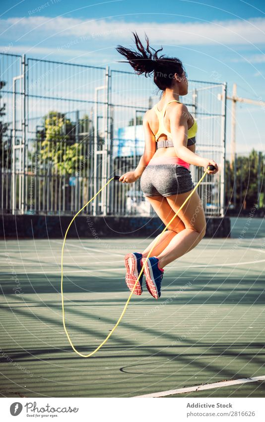 Fitness woman doing skipping workout with jump rope Sunlight Model Thin Preparation Action Park copy Athletic Practice Racing sports Day Adults Sunbeam