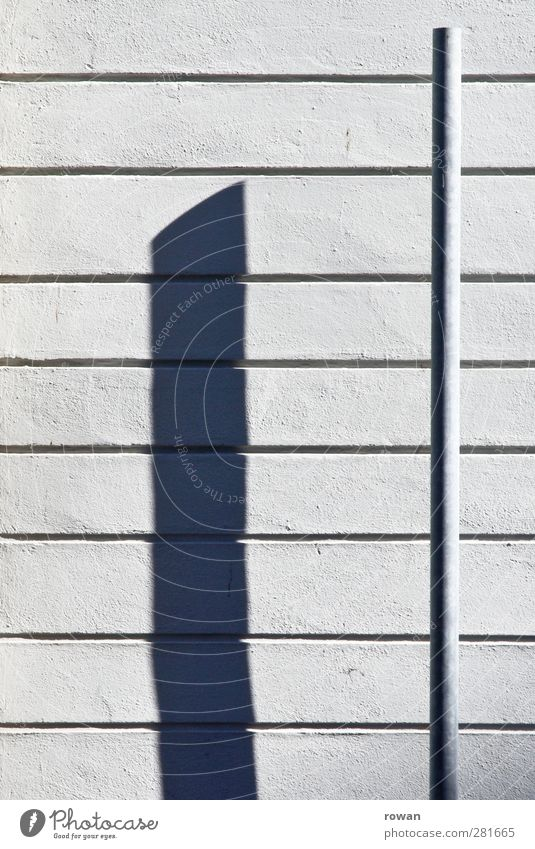 shadow cast Manmade structures Wall (barrier) Wall (building) Facade Esthetic Line Lined At right angles Drop shadow Rendered facade White Graphic Contrast