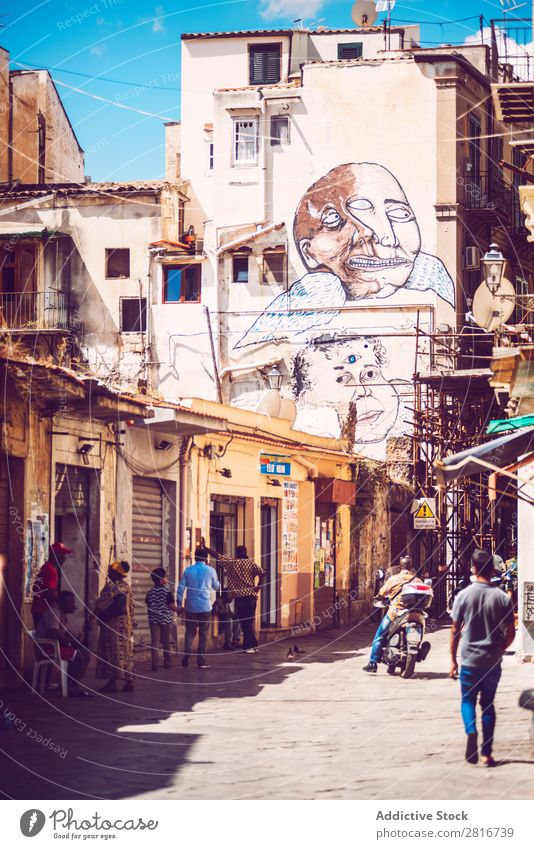 PALERMO, ITALY - JULY 17, 2016: people doing normal life in a poor neighborhood, on July 17, 2016 in Palermo, Sicily, Italy Ancient Architecture Vientiane City