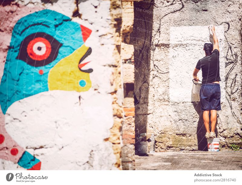 PALERMO, ITALY - JULY 17, 2016: Artist making a street art painting, on July 17, 2016 in Palermo, Sicily, Italy Ancient Architecture Vientiane City Europe