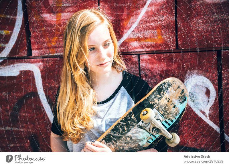 Cool skateboard woman at a public graffiti park Girl Skateboard Street Ice-skating Graffiti Woman Hat Cool (slang) Exterior shot Human being Leisure and hobbies