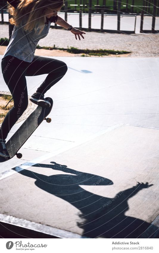 Skateboarding woman practicing at skatepark asian Action Exterior shot Sunlight Ramp Park committed ollie determined Movement Human being 1 Woman Energy