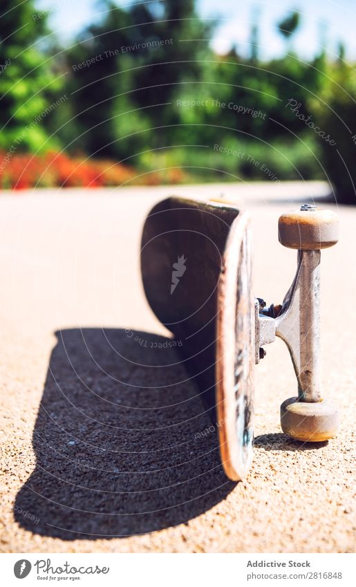 Old used skateboard over the ground Skateboard Skateboarding Wheels Retro Isolated Dirty Leisure and hobbies Joy Action Park Vantage point Horizontal Shot