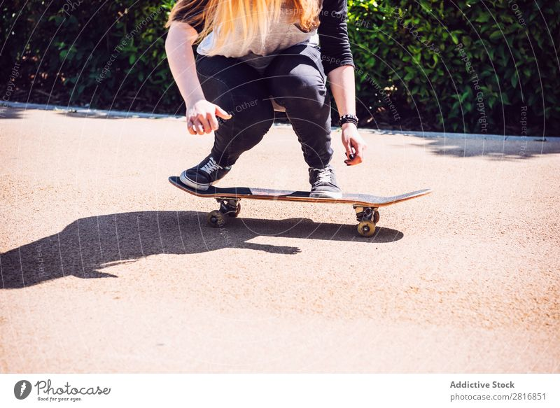 Skateboarder woman practicing ollie at park asian Action Exterior shot Sunlight Ramp Park Skateboarding committed determined Movement Human being 1 Woman Energy