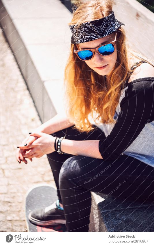 Woman skateboarder sitting in a park asian Skateboarding Sunglasses Joy Park Hat Chinese Music Town Culture Cap Exterior shot Sit Fitness 1 Black Hold Smiling