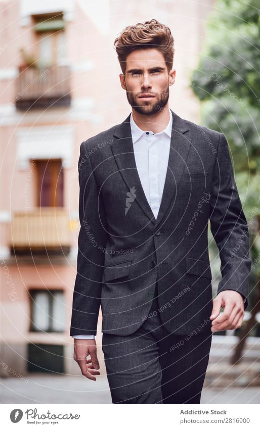 Handsome elegant young fashion man in trendy costume suit walking down the street Suit Man Gentleman Fashion fashionable Clothing Style Model Shirt Easygoing