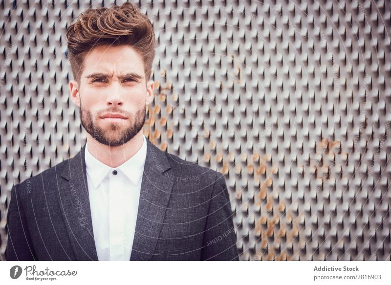 Handsome elegant young fashion man in trendy costume suit, metal fence background Suit Man Gentleman Fashion fashionable Clothing Style Model Shirt Easygoing