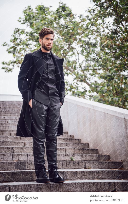Young handsome trendy man with coat posing on stairs Adults Attractive Beard bearded Boy (child) Easygoing Caucasian Cool (slang) Cute Deep Expression