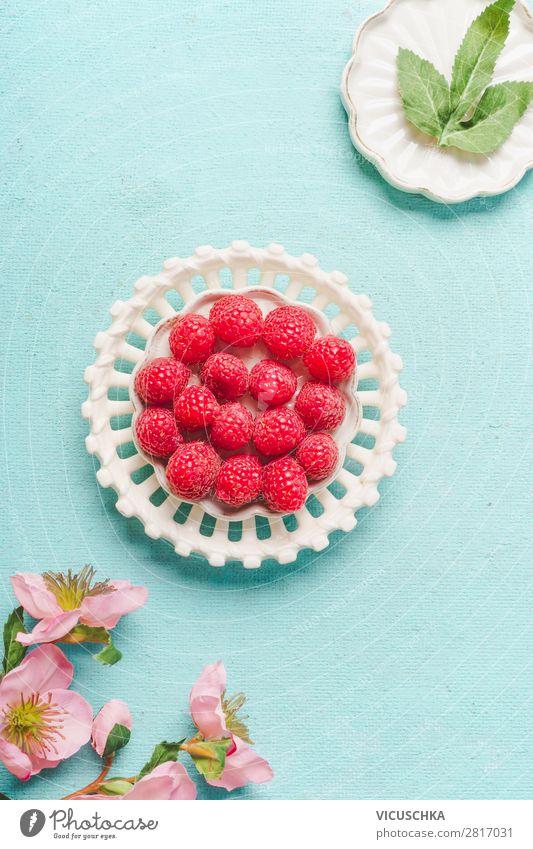 Raspberries on light blue background Food Fruit Dessert Nutrition Breakfast Organic produce Vegetarian diet Diet Plate Style Design Healthy Eating Summer
