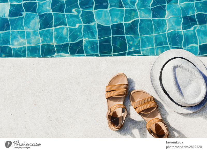 flat lay with woman's sandals and hat front of the pool Hotel Exterior shot Sports Swimming & Bathing Background picture Blue Hat Vacation & Travel